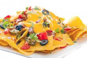 nachos on white plastic plate