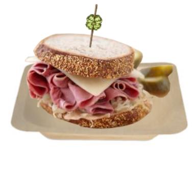 ruben sandwich on wood plate